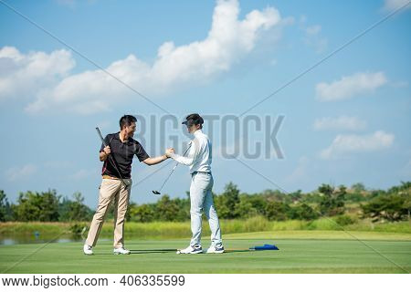 Group Golfer Sport Course Fairway. People Man Lifestyle Congratulation And Shake Hand After Putting