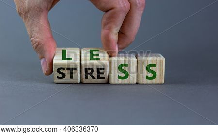 Having Less Stress Or Being Stress-less. Businessman Turns Wooden Cubes And Changes The Word 'stress