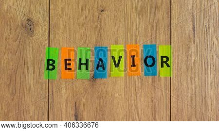 Behavior Symbol. Concept Word 'behavior' On Colored Papers On A Beautiful Wooden Background, Copy Sp