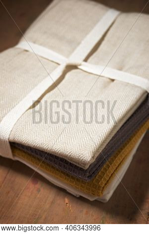 Dishcloths on a wooden table.