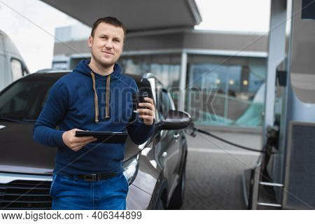 Car Refueling, Business, People Concept. Portrait Of Handsome Young Caucasian Man In Casual Outfit,