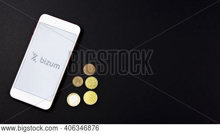 Spain, 02, 03, 2021. Overhead Shot Of A Smartphone With The Bizum Application Home Screen Together W