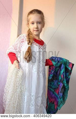Pretty Little Girl In Red And White Hats At Home. Concept Of Young Fashionista