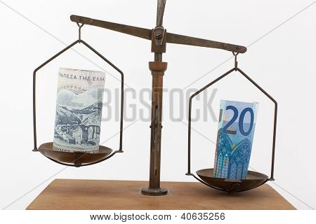 Euro And Greek Drachma On A Scale
