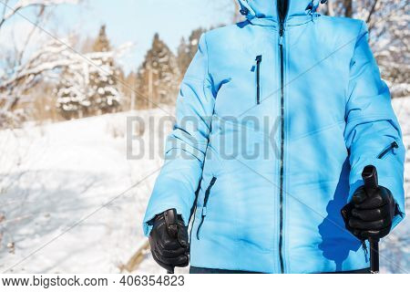 Nordic Walking In Winter. Female Hands In Gloves Holding Nordic Walking Sticks, Close-up. Active Lif
