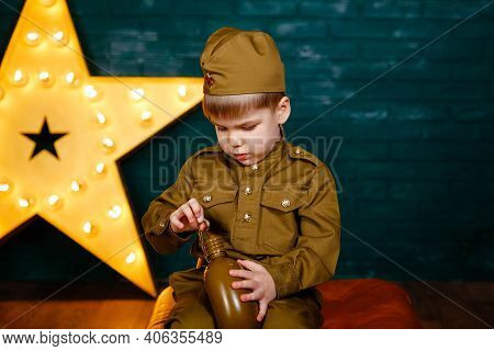 Soldier - The Defender Of The Fatherland. Happy Smiling Child Boy In Military Uniform. Little Patrio