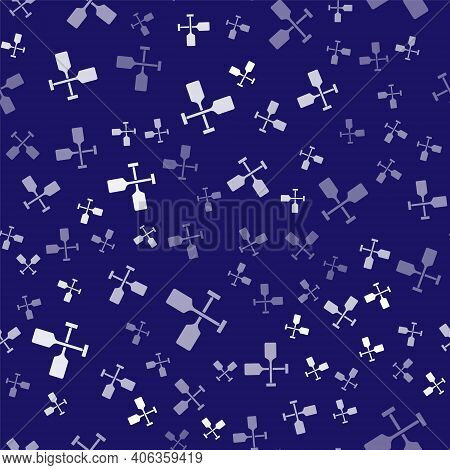 White Paddle Icon Isolated Seamless Pattern On Blue Background. Paddle Boat Oars. Vector