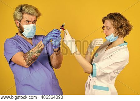 Injection In Hospital. Stop Coronavirus. Virus Infection Injection Vaccine. Doctors Wear Respirator
