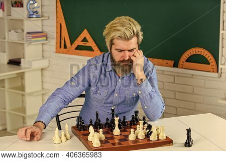 Moving Piece During Tournament. Moving Pieces On Chess Board. Man Hold Chess Piece. Concentrated Man