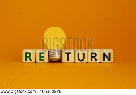 Return Symbol. Wooden Cubes With Word 'return'. Yellow Light Bulb. Beautiful Orange Background. Busi