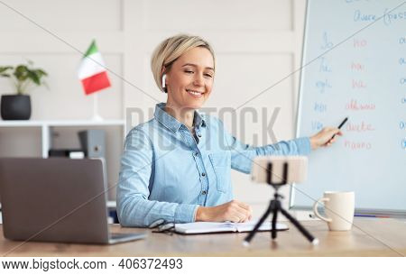 Teaching Italian Online. Positive Female Tutor Conducting Remote Foreign Language Class, Using Smart