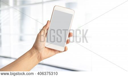 Lady Woman Hand Holding Mobile Phone With Copy Space.