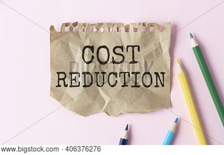 Cost Reductions Words On Copybook Page. Production Or Reselling Business Concept For Reduction Expen