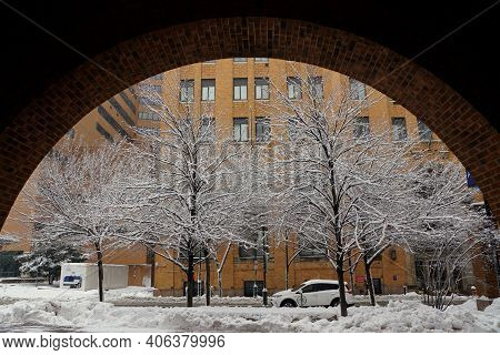 Philadelphia, Pennsylvania, U.s.a - February 2, 2021 -the Traffic On The Slippery Road By 11th And W
