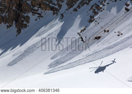 Shadow From Helicopter On Snowy Off-piste Slope With Traces From Avalanches At Sunny Winter Day. Res