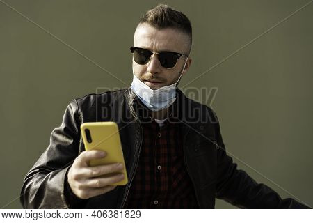 Man With Yellow Cell Phone Wearing Open Face Protective Mask During Coronavirus Outbreak - Hipster M