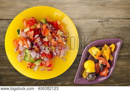 Vegan Food. Salad From Vegetables Pepper, Tomato, Onions, Broccoli On Yellow Plate Whit Vegerarian S