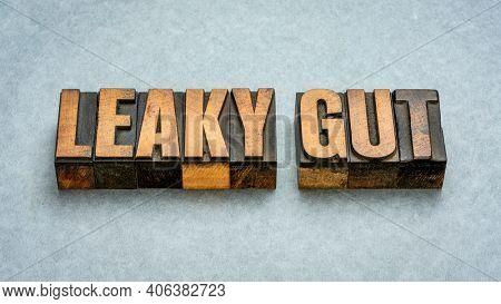 Leaky gut - word abstract in vintage letterpress wood type printing blocks, digestive health concept