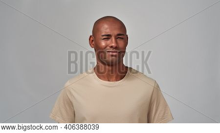 Male Looking Forward With A Smirk While Lowering His Brows Sceptically And Turning Head