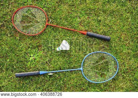 Shuttlecock And Badminton Racket Equipment On Grass