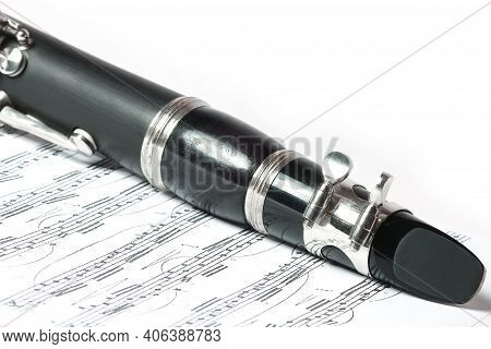 Clarinet On White Background With Instrument Notes