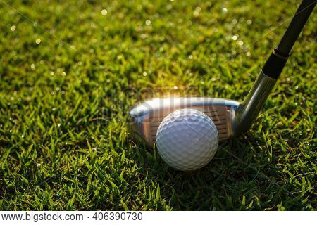 Golf Club And Ball In Green Grass. Golf Balls On The Golf Course With Golf Clubs Ready For Golf In T