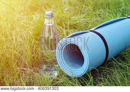 Yoga, Fitness Or Tourist Mat On The Green Grass. Mat For Sports In The Park. Tourist Mat.