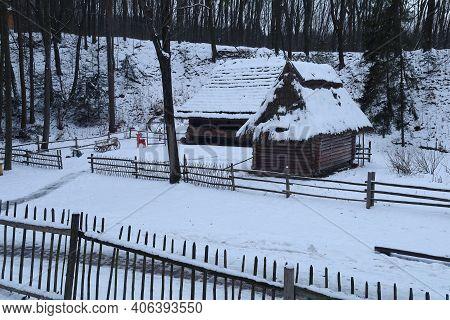 Lviv, Ukraine - January 31, 2021: Old Wooden Retro House In The Shevchenko Grove Old Village In Wint
