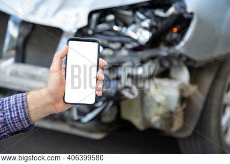 White Mockup Screen Mobile Phone In Male Hands After Car Accident. Mock Up For Insurance Service, Dr