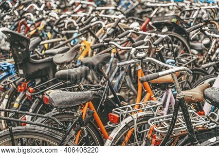 Bicycle Parking With Lot Of Bicycles, Rainy Day, Urban Iconic Transport In Amsterdam.