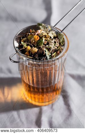 Herbal Tea With Chamomile, Rose And Mint On Gray Background. Home Remedy Concept