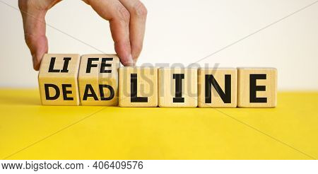 Lifeline Or Deadline Symbol. Businessman Turns Wooden Cubes And Changes The Word 'deadline' To 'life