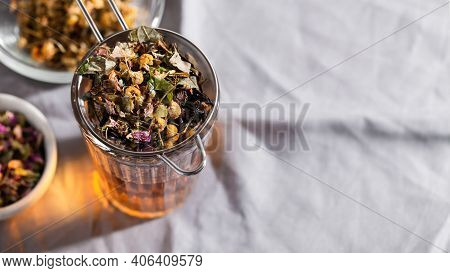 Herbal Tea With Chamomile, Rose And Mint On Gray Background With Copy Space. Home Remedy Concept