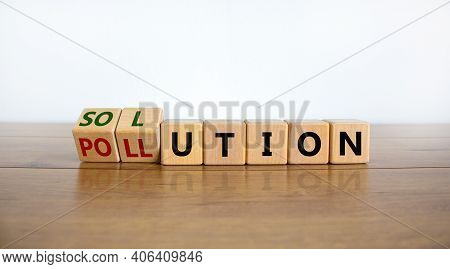 The Solution To Pollution Symbol. Fliped Wooden Cubes And Changed The Word 'pollution' To 'solution'