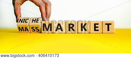 Mass Or Niche Market Symbol. Businessman Flips Wooden Cubes And Changes Words 'mass Market' To 'nich