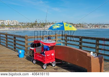 Tourist Walking On The Oceanside Pier During Blue Summer Day, Oceanside, Northern San Diego County,