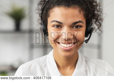 Headshot Of Friendly African American Millennial Woman In Headset, Smiling And Working In Emergency