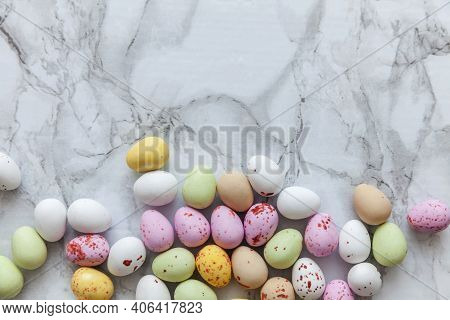 Happy Easter Concept. Preparation For Holiday. Easter Pastel Candy Chocolate Eggs Sweets On Trendy G