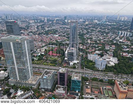 Aerial View Of Bni Life Building In Jakarta And Noise Cloud With Cityscape. Bni Life Is The Best Ins