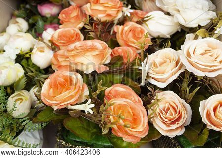 Lot Of Artificial Rose Flowers On Ground. Flowers For Sale For Memorial Day