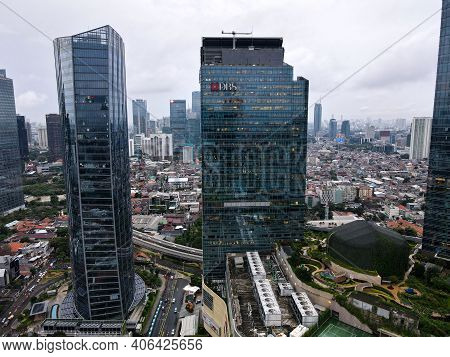 Aerial View Of Dbs Bank Building In Jakarta And Noise Cloud With Cityscape. Dbs Bank Comes From Sing