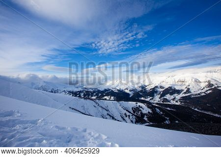 Snow Peaks Of Mountains With Blue Sky And Beautiful Clouds.