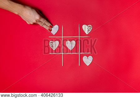 Valentines Tic Tac Toe Game, Isolated On Red Background With Female Hand.