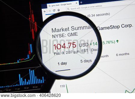 Montreal, Canada - February 3, 2021: Gme Gamestop Price Over Chart Under Magnifying Loop. Gamestop G
