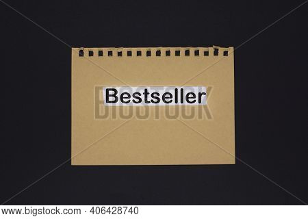 The Text Bestseller On Craft Paper On A Black Background. Business Concept Image