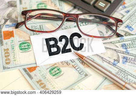 Finance And Business Concept. On The Table Are Bills, Glasses, Pen And A Sign On Which It Is Written