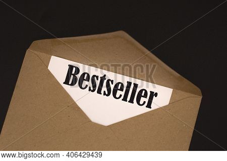 A White Sheet With The Text Bestseller Lies In An Open Craft Envelope On A Black Background
