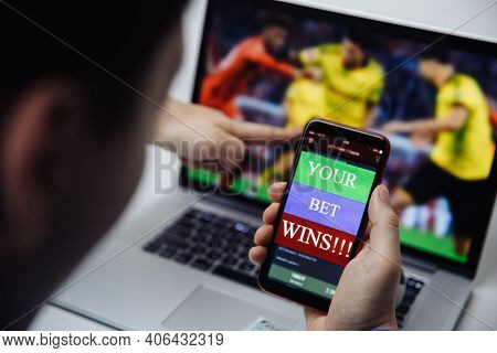 Man Watching Football Online Broadcast On His Laptop And Celebrate Victory In Betting At Bookmakers