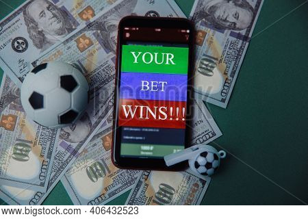 Ball, Whistle And Smartphone With Bet Application On Cash And Green Background. Gambling And Bet Con