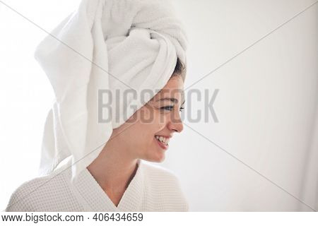 smiling woman with towel on head